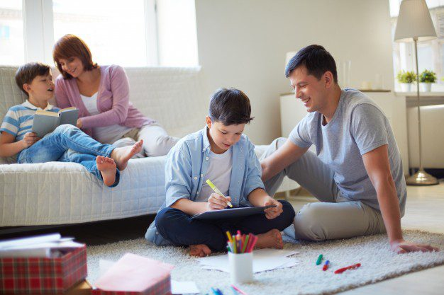 family spending some fruitful time together, parents encouraging kids to learn