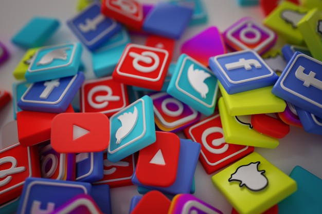 pile of social media logos piling up our lives